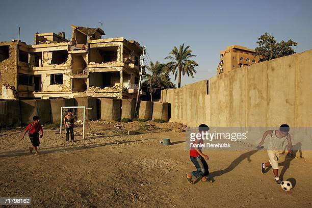Young Iraqi boys play soccer amongst protective blast walls on September 6 2006 in Baghdad Iraq It was here on October 14 2005 two suicide bombers...