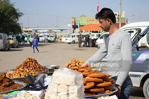 Young Iraqi man sells sweets in Baghdad Iraq .. Baghdad Photography Rasoul Ali