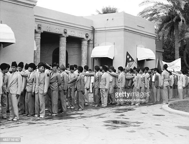 Young Iraqis offer the fascist salute to His Majesty King Faisal during the celebration of Iraq becoming a member of the League of Nations Baghdad...