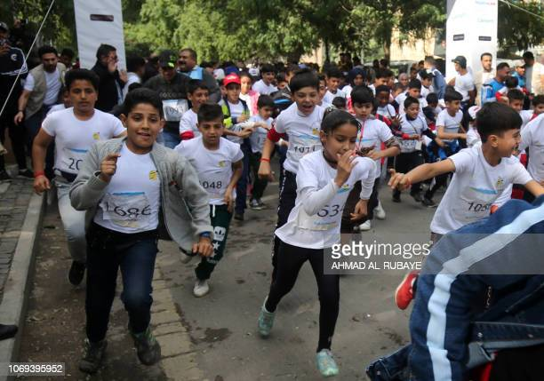 Young Iraqis run in the first children's marathon run in the capital Baghdad on December 7 2018