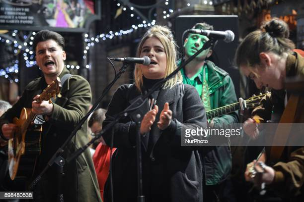 Young Irish musicians join Glen Hansard and take part in the annual Christmas Eve busk in aid of the Dublin Simon Community outside the Gaiety...