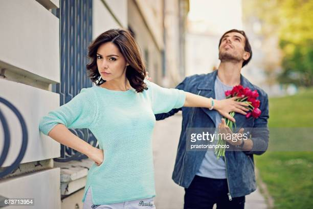 young is girl is rejecting boy on the street - dismissal stock photos and pictures