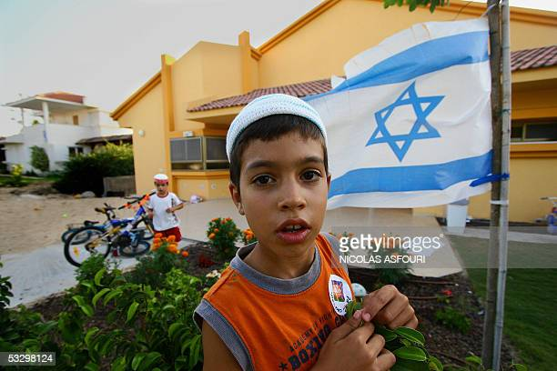 Young Israeli settlers play outside their home in the Gush Katif settlement of Neve Dekalim southern Gaza strip 28 July 2005 Some 8000 settlers will...