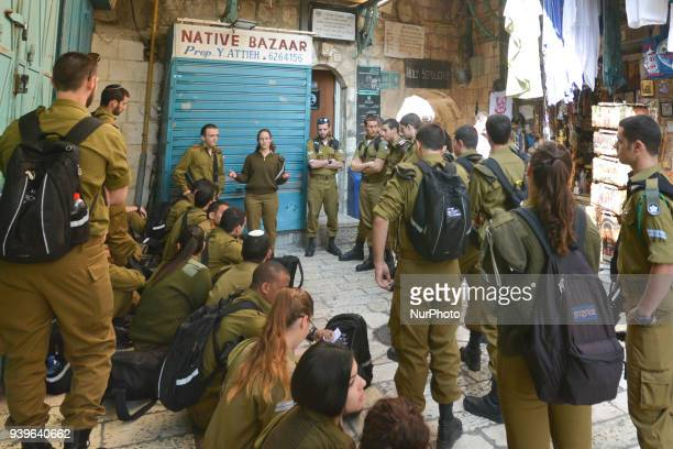 Young Israeli soldiers outside the entrance gate to the Holy Sepulchre church in the Old Town of Jerusalem Wednesday 14 March 2018 in Jerusalem Israel