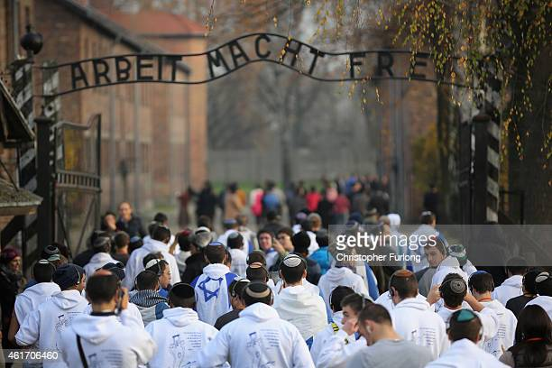 Young Israelis walk under the infamous German inscription that reads 'Work Makes Free' at the main gate of the Auschwitz I extermination camp on...