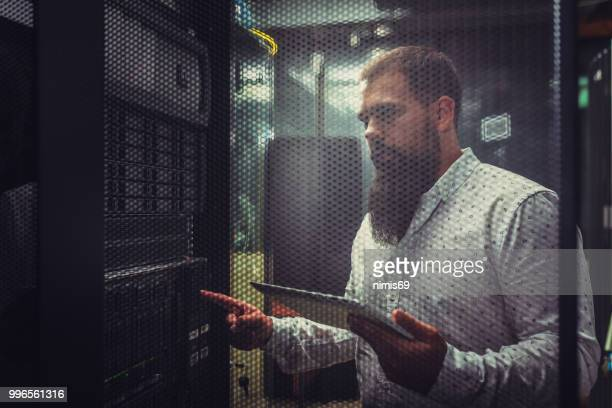young it engineer inspecting data center servers - data center stock pictures, royalty-free photos & images