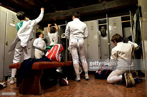 Young Italian fencers dress up in the locker room before a training session at the Musumeci Greco Academy on April 18 2016 in Rome The Academy of...