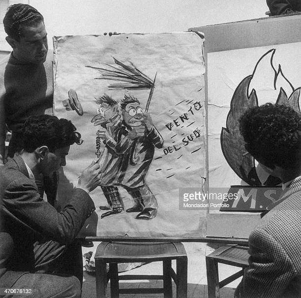 Young Italian Social Movement supporters preparing posters against Palmiro Togliatti and Alcide De Gasperi during the local elections Italy 1952