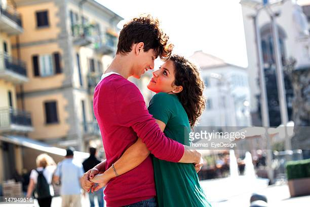 Young italians greeting each other on city street stock photo keywords m4hsunfo