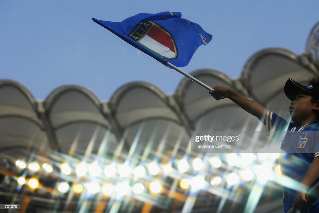 A young Italy fan waves his flag during the FIFA World Cup Finals 2002 Group G match between Italy and Croatia played at the Ibaraki-Prefecutural Kashima Soccer Stadium, in Ibaraki, Japan on June 8, 2002. Croatia won the match 2-1. DIGITAL
