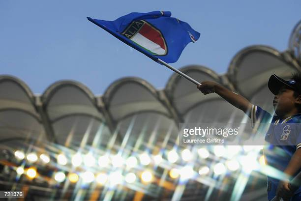 A young Italy fan waves his flag during the FIFA World Cup Finals 2002 Group G match between Italy and Croatia played at the IbarakiPrefecutural...