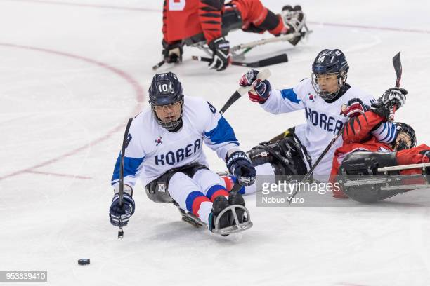 CHO Young Jae and JUNG Seung Hwan of KOREA are in action during the Men's Ice Hockey Playoffs Semifinals betwen KOREA and CANADA on day 6 of the...