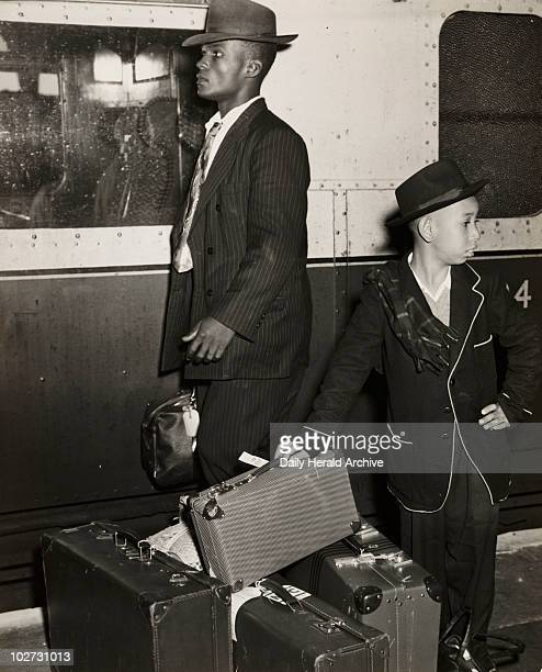 Young Jamaican boy looks after his family's luggage September 1954 A photograph of eightyearold Lawrence Fray looking after his family's luggage on a...