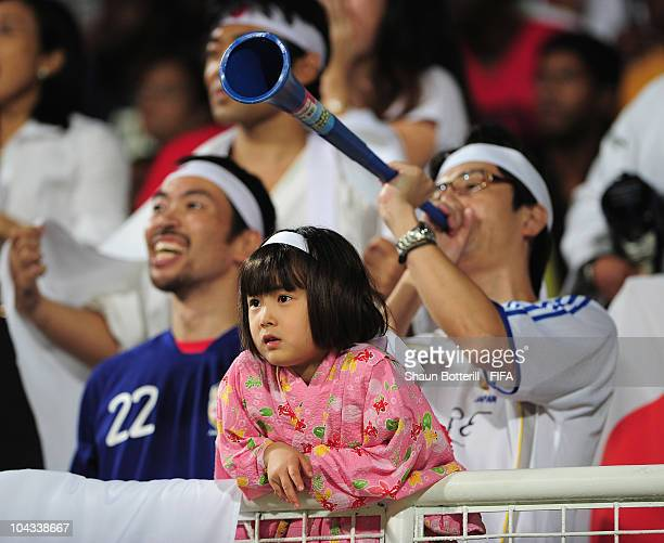 Young Japan fan cheers the team on during the FIFA U17 Women's World Cup Semi Final match between North Korea and Japan at the Ato Boldon Stadium on...