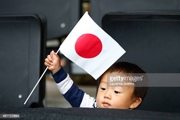 A young Japan fan flies the flag during the 2015 Rugby World Cup Pool B match between Samoa and Japan at Stadium mk on October 3 2015 in Milton...