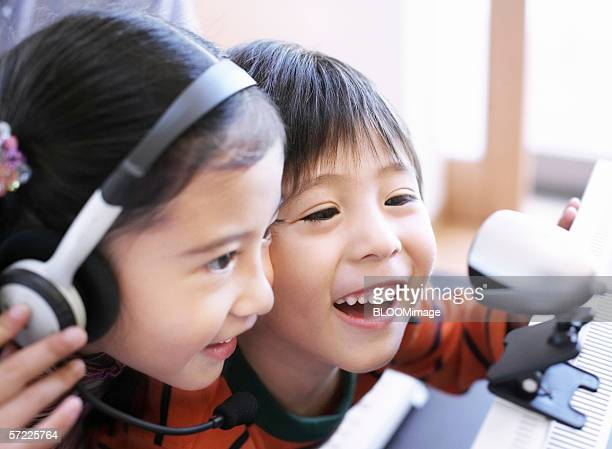 young japanese boy and girl chat by using internet - very young webcam girls stock photos and pictures