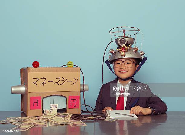 Young Japanese Boy in Business Suit Makes Money