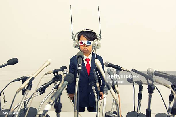 young japanese boy with headset and microphones - 記者会見 ストックフォトと画像