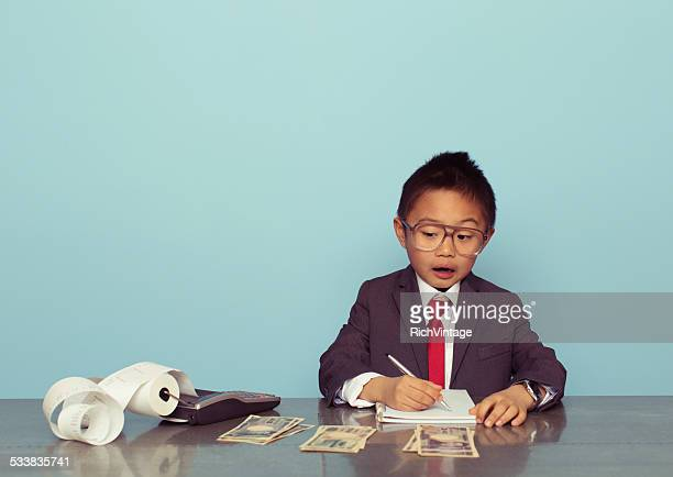 Young Japanese Business Boy is Counting Money