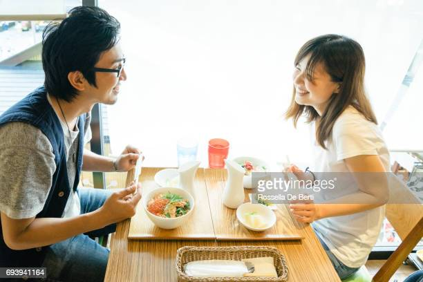 Young Japanese couple having lunch