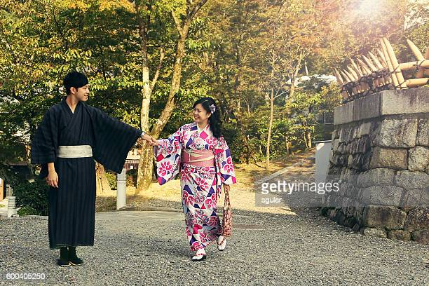 young japanese couple outdoors - japan stock photos and pictures
