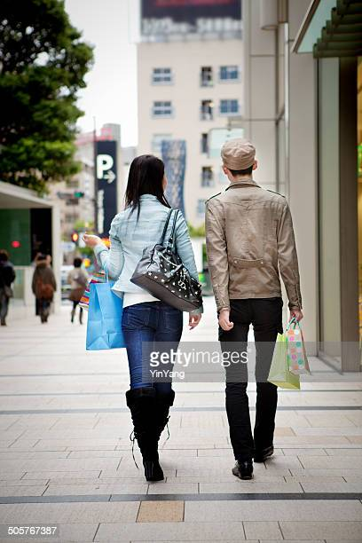 young japanese couple shopping in tokyo japan - beautiful bums stock photos and pictures