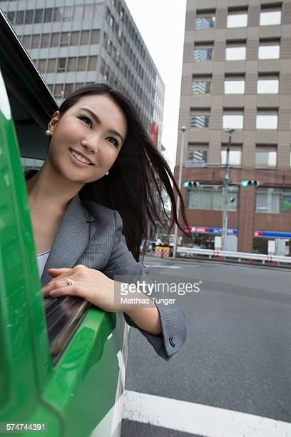 Young Japanese enjoying her cab ride