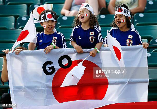 Young Japanese fans cheer for their team during the FIFA Women's World Cup Canada Semi Final match between England and Japan at Commonwealth Stadium...
