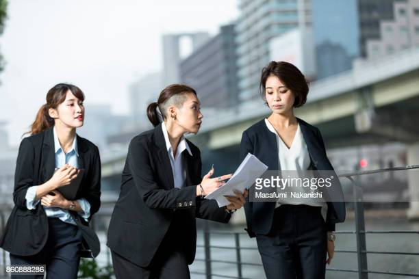 Young Japanese female business leader and her team