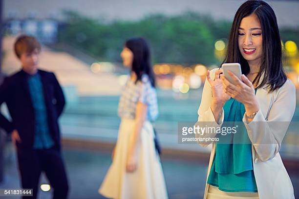Young Japanese girl is texting