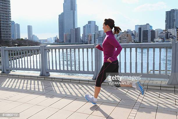 Young Japanese girl jogging