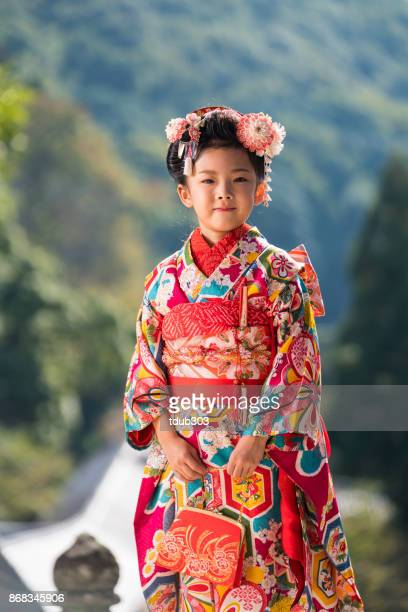 A young Japanese girl wearing a traditional kimono while celebrating her shichi go san