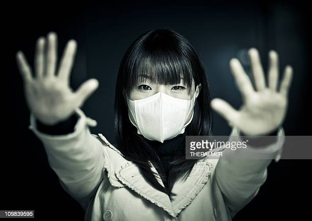 young japanese girl with surgical mask