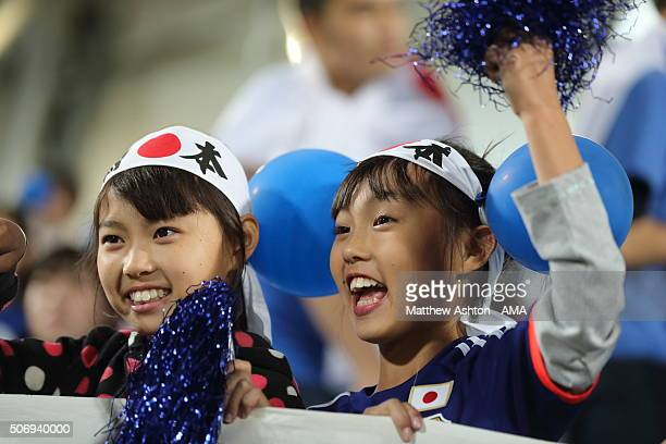 Young Japanese girls cheer on their team during the AFC U23 Championship semi final match between Japan and Iraq at the Abdullah Bin Khalifa Stadium...