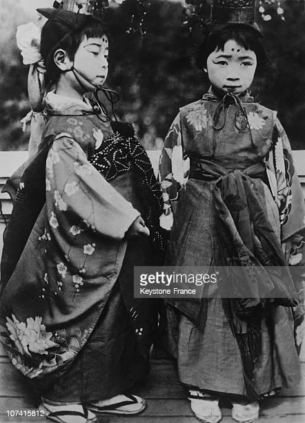 Young Japanese Girls Dressed For A Feast