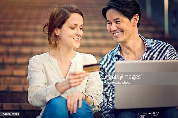Young Japanese man and Caucasian girl are shopping