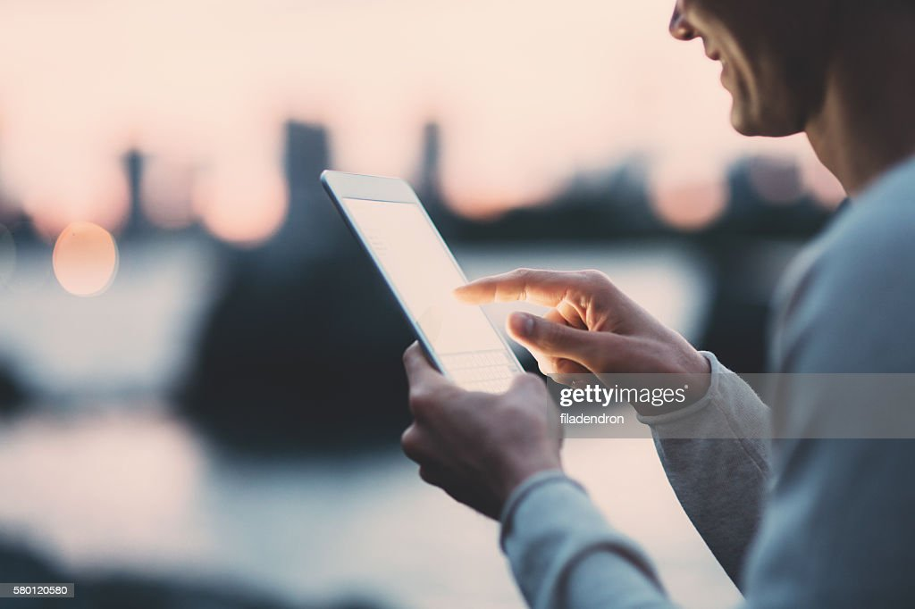 Young japanese man texting on the tablet : Stock Photo