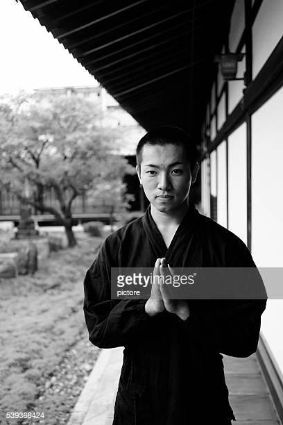 young japanese monck praying - prayer pose greeting bildbanksfoton och bilder