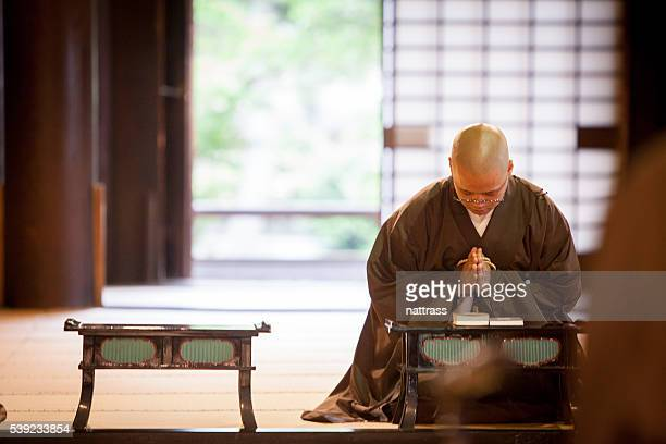 young japanese monk praying inside the temple - monk stock pictures, royalty-free photos & images