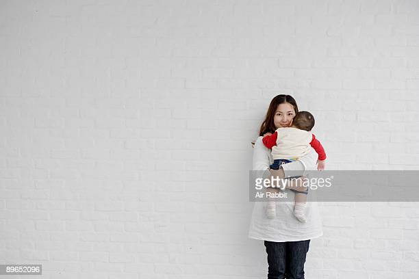 Young Japanese mother and baby Trust,
