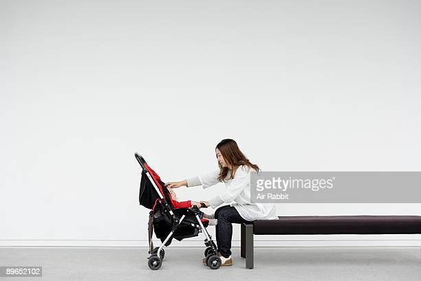 Young Japanese mother and sleeping baby Trust,