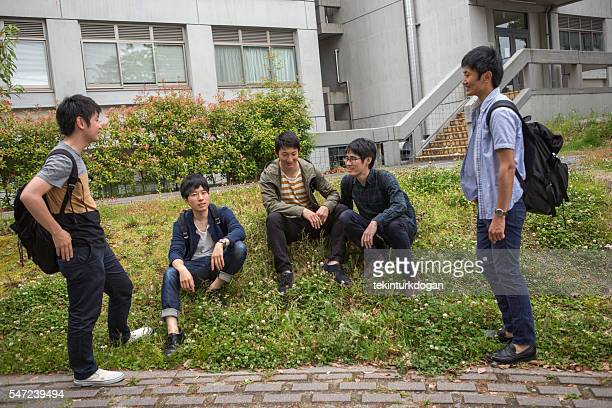 Young japanese student waiting in garden at kyoto japan