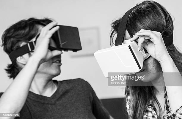 young japanese students enjoying virtual reality console - head mounted display stock photos and pictures