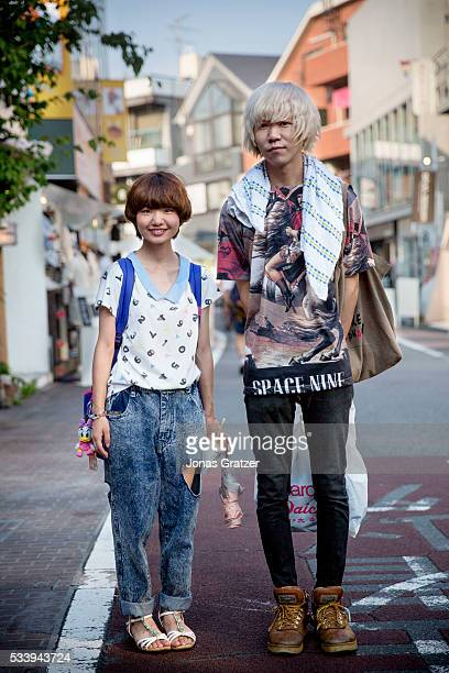 Young Japanese woman and man shopping in the Harajuku area of Tokyo