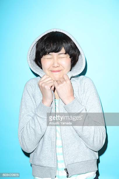 Young Japanese woman excited,blue background