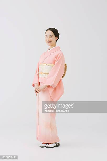 young japanese woman in a traditional kimono against white background - kimono stock pictures, royalty-free photos & images