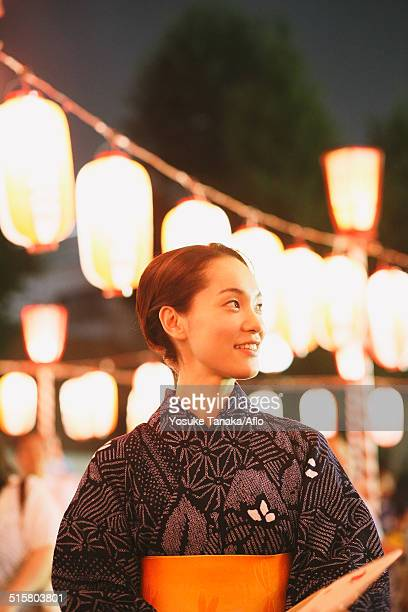 young japanese woman in a traditional kimono at a summer festival - ボン ストックフォトと画像
