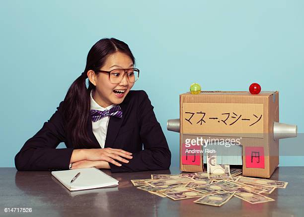 Young Japanese Woman in Business Suit makes Money