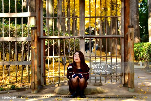 young japanese woman jumping and swirling in otaguro park, tokyo - suginami stock photos and pictures