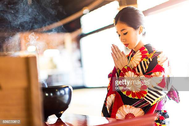 Young Japanese Woman Praying at Hyakumanben Chionji Temple, Kyoto, Japan